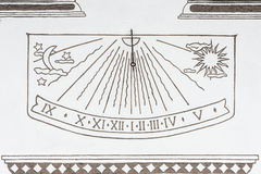 Ancient solar clock on the wall of a rural house in Canazei, Italy Royalty Free Stock Image