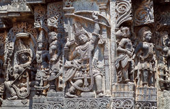 Ancient soldier with bow and arrow on the Hindu temple walls. 12th centur Hoysaleshwara temple in Halebidu, India. Royalty Free Stock Photo