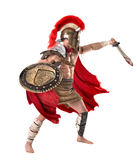 Ancient soldier or Gladiator. Ancient warrior or Gladiator posing over a white background Stock Image