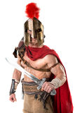 Ancient soldier or Gladiator. Ancient warrior or Gladiator posing over a white background Royalty Free Stock Photos