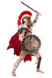 Ancient soldier or Gladiator. Ancient warrior or Gladiator posing over a white background Stock Photography