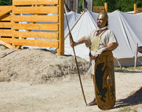 Ancient Soldier Guarding the Encampment. AQUILEIA, Italy - June 18, 2017 : Soldier guarding the entrance of an ancient roman military encampment at the local Royalty Free Stock Image