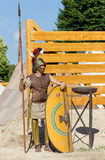 Ancient Soldier Guarding the Encampment. AQUILEIA, Italy - June 18, 2017 : Soldier guarding the entrance of an ancient roman military encampment at the local Stock Images