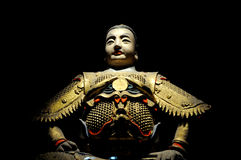Ancient soldier statue. A Chinese Ancient man statue against black.Taken in Wu Hou Shrine of Chengdu,initially built in 223AD,now covers 140,000 square meters.It Stock Photos
