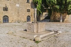 Very old source of water on the medieval square of Argyrokastro. Rhodes Old Town, Greece. An ancient source of water in the medieval square of Argyrokastru stock photography
