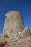 Ancient Spanish tower at Vignola Mare Royalty Free Stock Photo