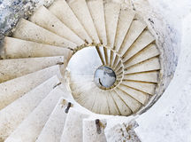 Ancient spiral stairs. Top view on a spiral stairs made of stone Stock Image