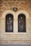 Ancient stained glass in the windows of the Orthodox Church Stock Photography