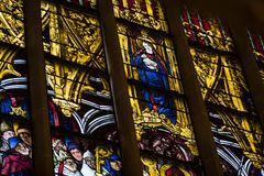 Ancient stained glass windows on a religious theme in the Cathedral of the Blessed Virgin Mary in Munich Germany. MUNICH, GERMANY - NOVEMBER 25, 2018 : Ancient royalty free stock photos
