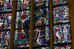 Ancient stained glass windows on a religious theme in the Cathedral of the Blessed Virgin Mary in Munich Germany. MUNICH, GERMANY - NOVEMBER 25, 2018 : Ancient royalty free stock photography