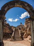Ancient staircase behind arch. View of an old stone staircase through the remains of an archway in a ruined cathedral - La Recoleccion, Antigua, Guatemala Stock Photos
