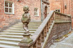 Ancient Staircase with a Boy Statue. Large Stair With and Ornamented Bronze Statue of a Young Boy from Stadshuset, Stockholm Stock Photography