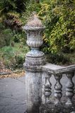 Ancient staircase with stone balusters against the background of green vegetation stock photography