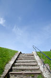 Ancient stairs. Surrounded by green grass Royalty Free Stock Photo