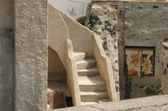 Ancient Stairway in Santorini. Whitewashed walls and stone stairs in old Santorini Stock Images