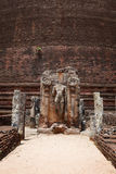 Ancient standing Buddha image Stock Photo