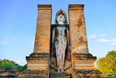 Ancient Standing Buddha Statue at The Buddhist Temple Ruins of Wat Mahathat in The Sukhothai Historical Park, Thailand Royalty Free Stock Images