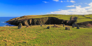 Ancient Standing stone circle above rugged and wild coastline Stock Images