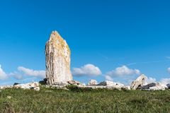 Ancient standing stone on a hill Stock Images