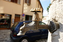 Ancient standpipe for public use. Verucchio, Italy Stock Photography