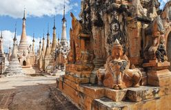 Ancient statue and bas-reliefs, Myanmar Stock Photography