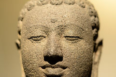 Young buddha head. Ancient statue of Buddhas head made from stone Stock Photography