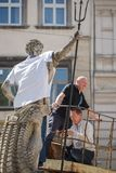 Lviv, UKRAINE - May 18, 2017. Neptune statue dressed in embroidered shirts. Vyshyvanka Day royalty free stock photography
