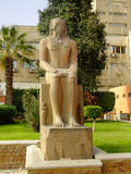 Ancient statue on display outside Egyptian museum, Cairo Royalty Free Stock Photo
