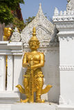 Ancient statue of the evil demon guarding the passage to the Buddha sculpture. Bangkok Royalty Free Stock Image