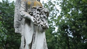 Ancient statue of guardian angel at old cemetery stock video footage