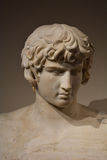 Ancient Statue Head of a beautiful young man Stock Photography
