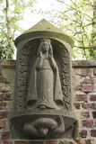 Ancient Statue Holy Mary on church wall Royalty Free Stock Photography