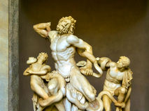 Ancient statue of Laocoon and his Sons in Vatican, Italy. The Trojan Laocoon was strangled by sea snakes with his two sons Stock Photos