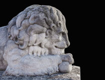 Ancient statue of a lion isolated on black background. Close stock photography