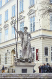 An ancient statue of Neptune in the central square of Lviv Royalty Free Stock Photography