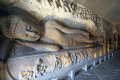 Ancient Statue of Reclining Buddha at Ellora Caves, India Royalty Free Stock Images
