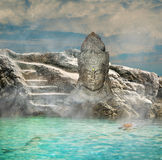Ancient statue in sea Stock Photos