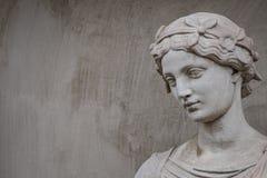 Ancient statue of sensual Greek renaissance era woman with a flo. Wer, Potsdam, Germany stock photos