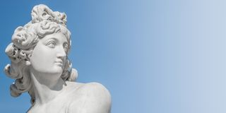 Ancient statue of sensual Italian renaissance era woman with long neck and curly hairs at blue sky gradient background, Potsdam,. Germany, details, closeup stock photo