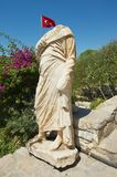 Ancient statue with Turkish National flag at the background in Bodrum, Turkey. royalty free stock photo