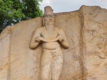 Stone statue of Sri Lankan King at Potgul Vihara in Polonnaruwa Stock Images