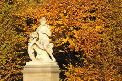 Ancient statue of woman in autumn park Royalty Free Stock Photo
