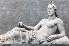 Ancient statue of a woman lying. View of an ancient statue of a woman lying Royalty Free Stock Image