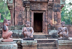 Ancient statues in Banteay Srey Temple, Cambodia. Ancient statues of Hindu God Garuda in Banteay Srey Temple in Angkor Area, Cambodia. Banteay Srey is a 10th Stock Image