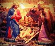 Ancient statues of Mary and Saint Joseph with little baby Jesus. In the crib at Christmas Royalty Free Stock Images