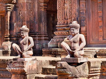 Ancient statues near the door Royalty Free Stock Image