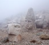 Ancient statues on the top of Nemrut mount, Anatolia, Turkey. Ancient stone statues on the top of Nemrut mount, Anatolia, Turkey. In 62 BC, King Antiochus I Royalty Free Stock Images