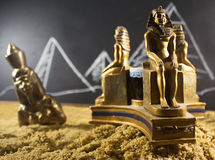 Ancient statuettes on sand. Royalty Free Stock Photography