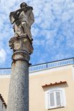 Ancient stature on stone column, Ischia. Ancient stature on stone column, old town of Lacco Ameno. Ischia, Italian island in the Tyrrhenian Sea Royalty Free Stock Photo