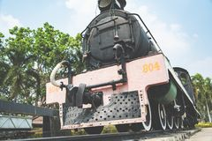 The ancient steam engine locomotive world war II train at Kanchanaburi, Thailand near river Kwai bridge Stock Photos